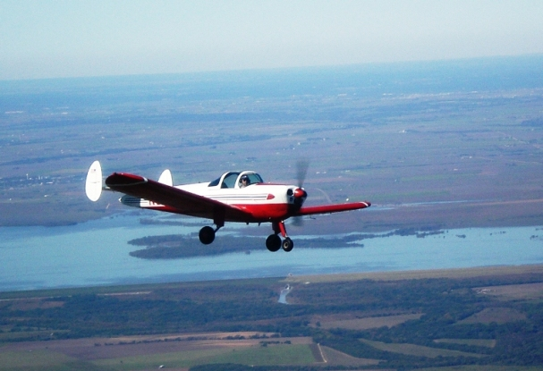 John Craparo flying N87197 just east of Granger Lake in Central Texas. It is a beautiful November day in 2009 as he makes his way between Georgetown, TX and Hilltop Lakes, TX where he will enjoy a $20 hamburger.