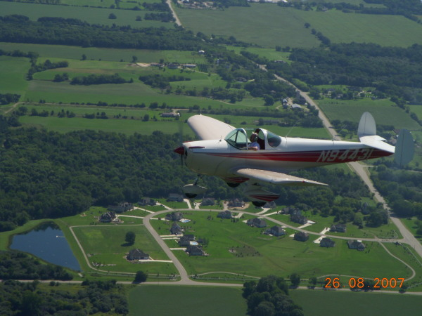 N94431 is owned by Cheryl Meloche and is a 1950 Model 415G. Is if flown by Urban Meloche somewhere over southeastern Wisconsin in August 2007. They Log over 100 hours per year on their Ercoupe and use their Mooney 201 for longer trips.
